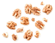 Peeled Walnuts With Slices On A White Background. The View From Top.
