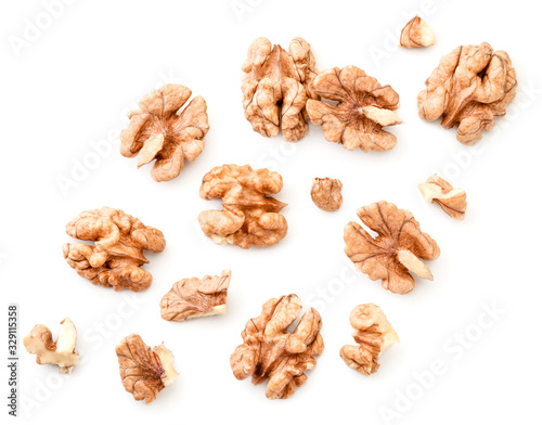 Fotografía Peeled walnuts with slices on a white background