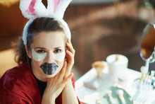Woman With Bunny Ears Making C...
