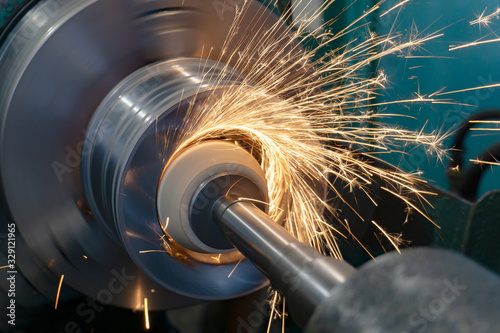 Obraz na plátně Internal grinding of a round part on a machine, with an abrasive stone with cooling