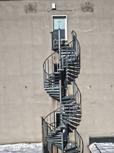 Spiral Metal Staircase Against...