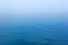 Vast Blue Sea With The Mist Ba...