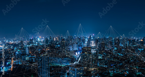 Modern city with wireless network connection and city scape concept.Wireless network and Connection technology concept with city background at night. - 329129792