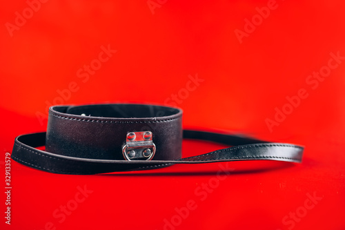 sex toys collar with leash isolated on red background Fototapete