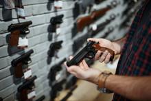 Man Holds Handgun In Gun Shop