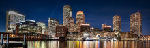 Downtown Panoramic City View Of Boston Massachusetts Looking Over The Riverfront Harbor At Night