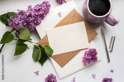 Photo card mockup with mug with black coffee with lilac