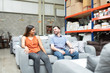 Happy Couple Sitting On Furniture In Store