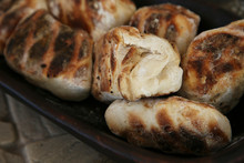 Traditional South African Roosterbrood. This Is A Popular Food Snack In South Africa. This Image Has Selective Focus.