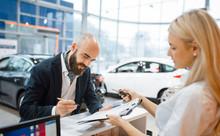 Man Signs A Contract In Car De...