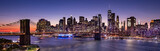 Fototapeta New York - Brooklyn Bridge over the East River and the Manhattan downtown city panoramic skyline at night in New York USA
