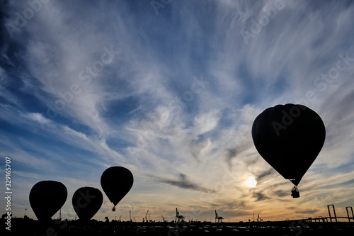 backlight of aerostatic balloons over the sky of Seville at dawn. Wallpaper Mural