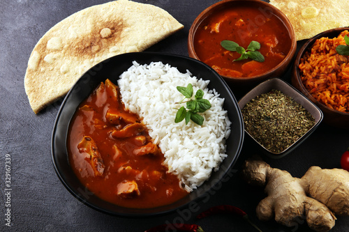 Slika na platnu Chicken tikka masala spicy curry meat food in pot with rice and naan bread