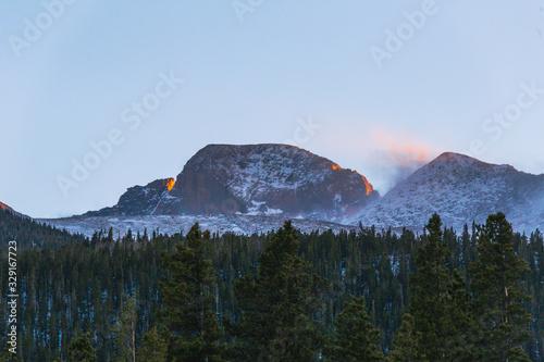 green pine trees sunlight hitting mountain during sunset