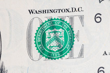 ONE Sign On Green Seal Symbol On One US Dollar Bill.
