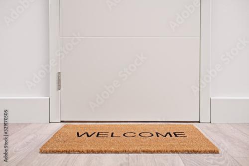 Fototapeta White door with a welcome mat obraz