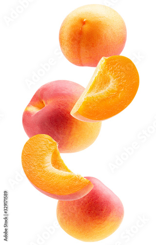 falling apricot slices isolated on a white background Canvas Print
