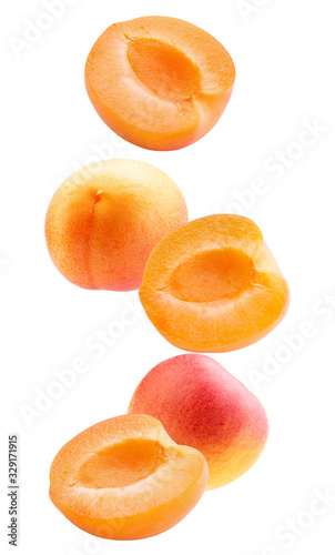 falling apricot slices isolated on a white background Wallpaper Mural