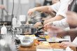 canvas print picture - Background cook leads master class in cooking in kitchen