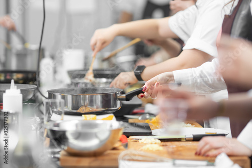 Fototapeta Background cook leads master class in cooking in kitchen obraz