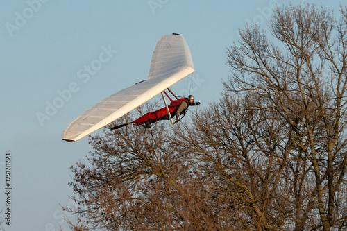 Hang glider pilot makes maneuvers Canvas Print