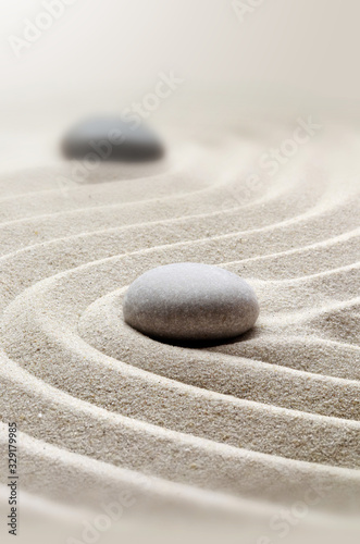 Fototapeta zen garden meditation stone background with stones and lines in sand for relaxation. obraz