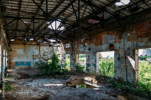 Old abandoned ruined industrial building overgrown by plants and trees Canvas