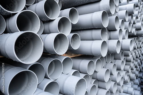 Leinwand Poster Gray PVC tubes plastic pipes stacked in rows