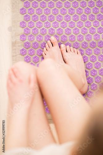 Female feet on acupressure mat Canvas Print