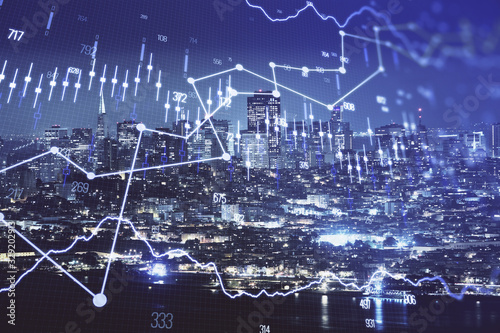 Photo Financial graph on night city scape with tall buildings background double exposure