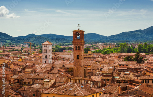 Stampa su Tela View of Lucca old historic center with medieval towers and belfries from above