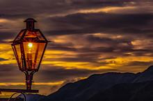 Lantern Shining At Sunset, With Orange Cloud Sky On Background