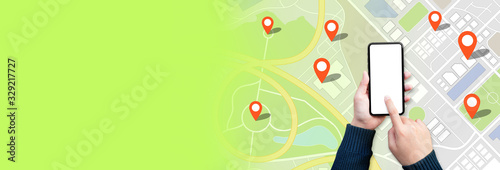 Fotografia Navigation and digital map concepts with young person using gps on smartphone an