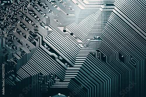 Fényképezés Blue electronic mother board circuit close up macro background.