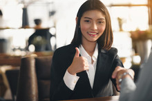 Businesswoman Thumbs Up And Sh...