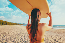 Women Serfer With Surfboard On Beach Background. Travel Adventure And Water Sport. Relaxation And Summer Vacation Concept. Retro Color Tone Effect.