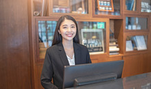 Asian Woman Hotel Receptionist...