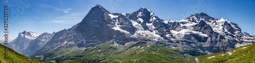 Switzerland, Panoramic view on Eiger, Monch and Jungfraujoch and green Alps arou Canvas Print