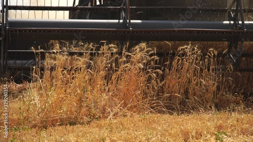 Aufkleber - Close up of combine harvester for harvesting wheat. Slow motion
