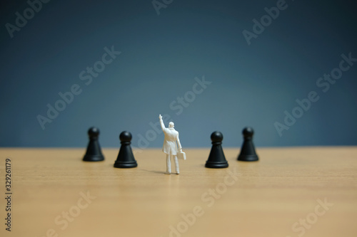 Business strategy conceptual photo - Miniature businessman pointing upside in th Canvas-taulu