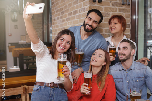 Group of friends taking selfies at beer pub Canvas Print