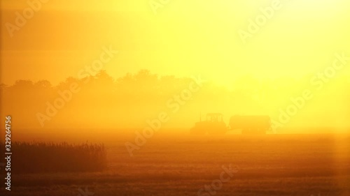 Aufkleber - A tractor at the field after harvesting. Slow motion