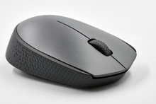 Black Optical Wireless Computer Mouse On White Background. Closeup