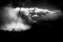 Cable Cars Under Cloudy Sky