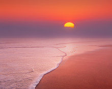 Beautiful Sunset On Beach With...