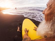 Happy Surfer Senior Sitting On...