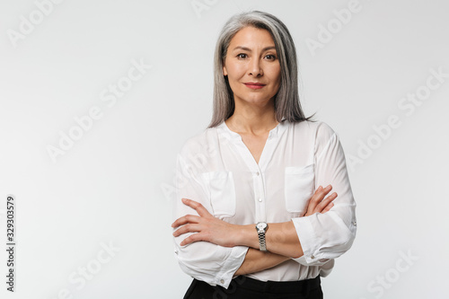 Image of adult mature woman with long gray hair wearing office clothes Wallpaper Mural