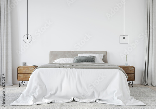 Fotografie, Obraz Bright bedroom with a wooden bedside table and a stylish chandeliers