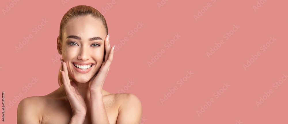 Fototapeta Girl With Nude Makeup Standing Over Pink Studio Background