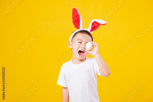 little children boy smile standing so happy bunny ears in Easter festival day ho Fototapete